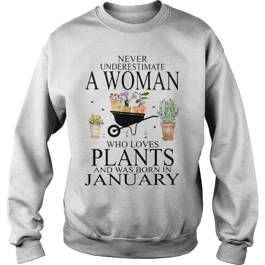 Never underestimate a woman who loves plants Sweater