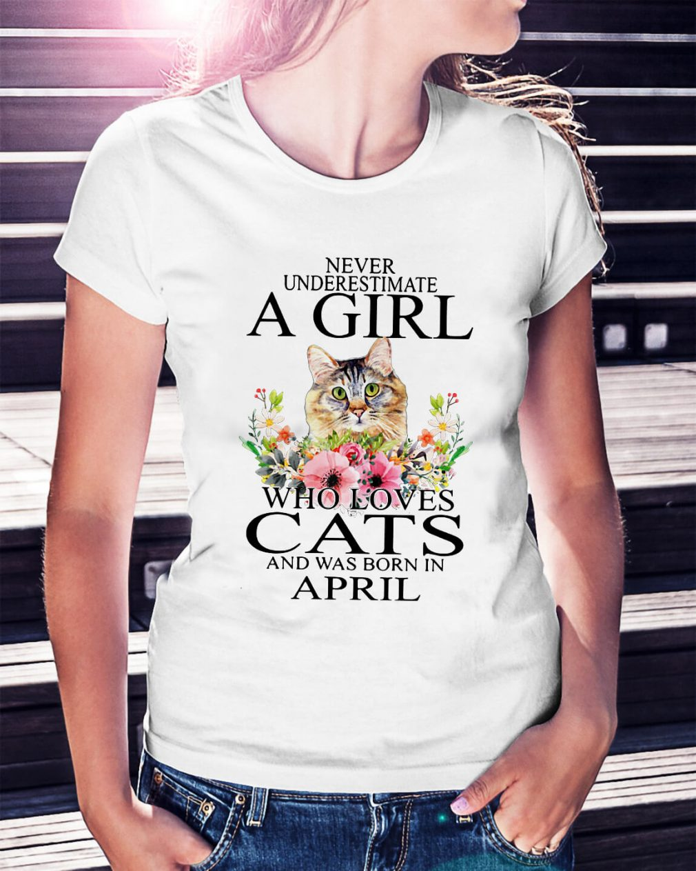 Never underestimate a girl who loves cats and was born in April shirt