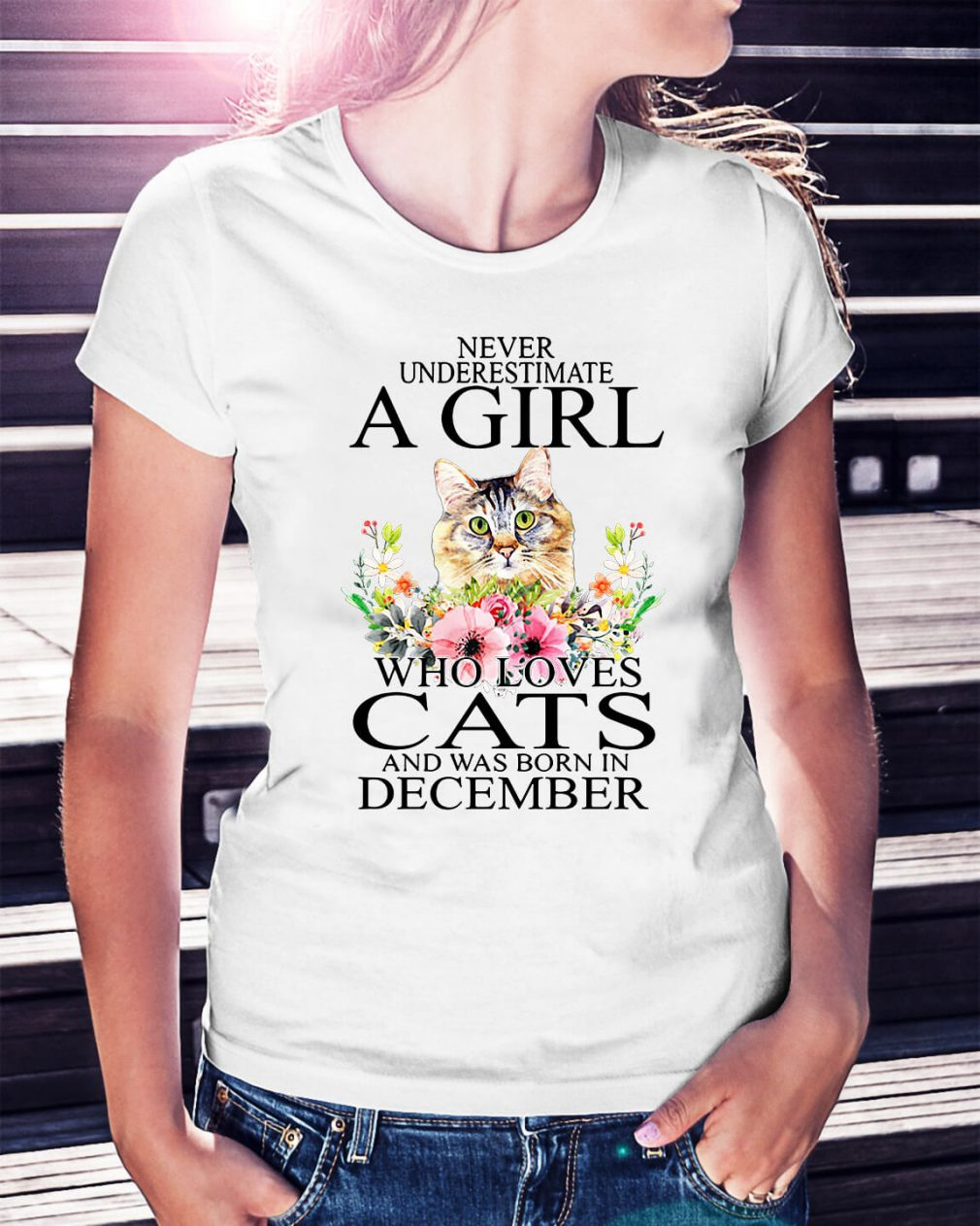 Never underestimate a girl who loves cats and was born in December shirt
