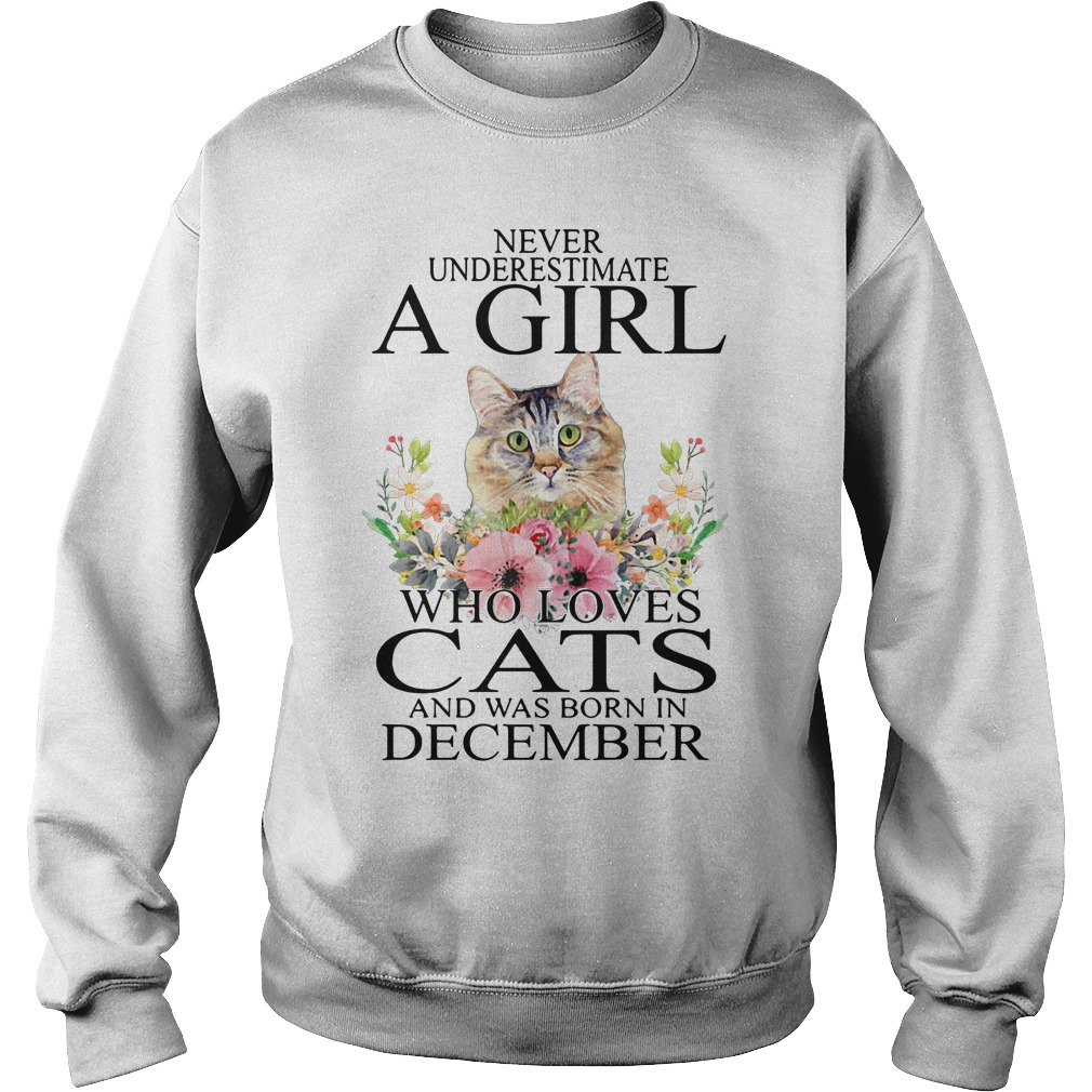 Never underestimate a girl who loves cats and was born in December Sweater