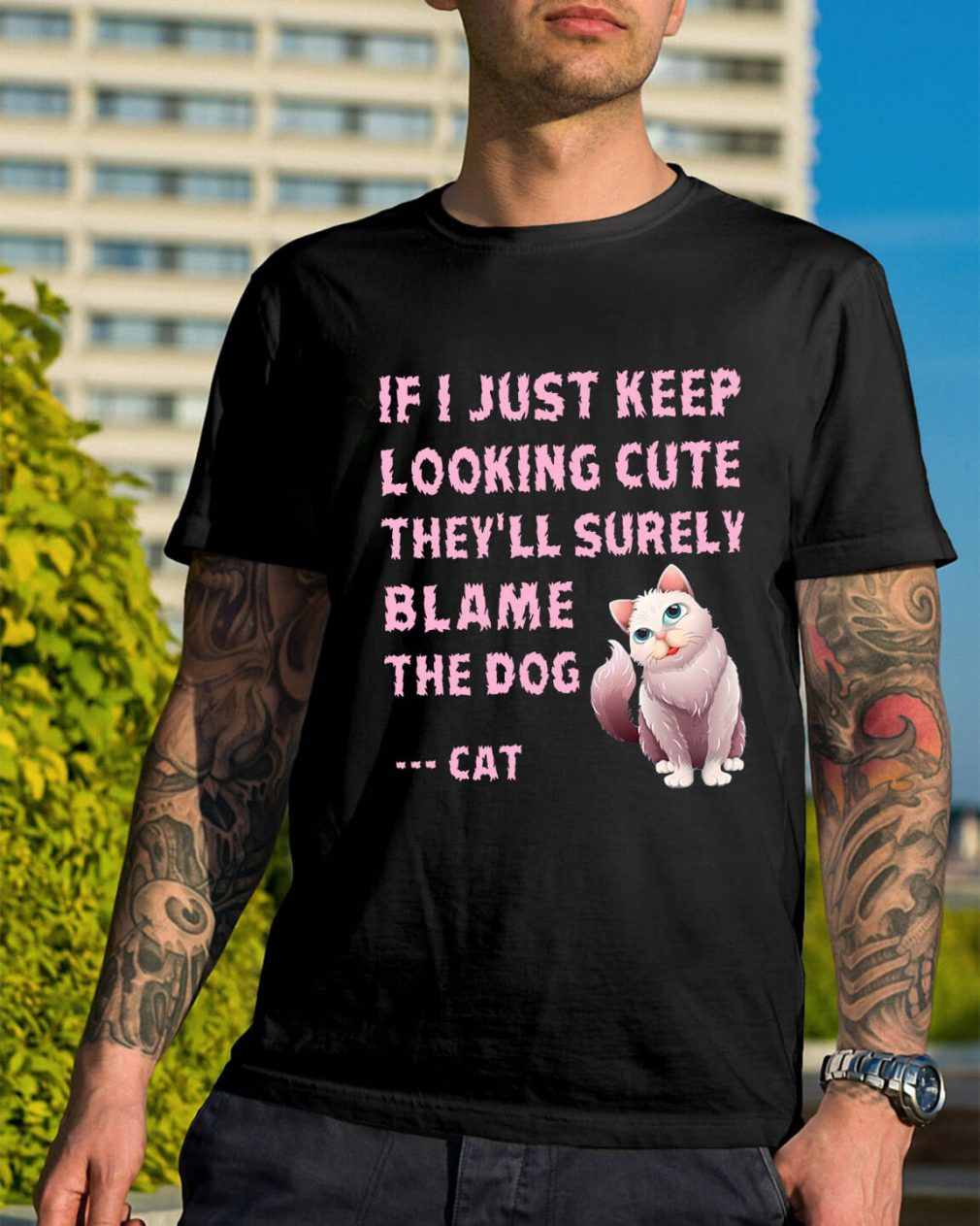 If I just keep looking cute they'll surely blame the dog cat shirt