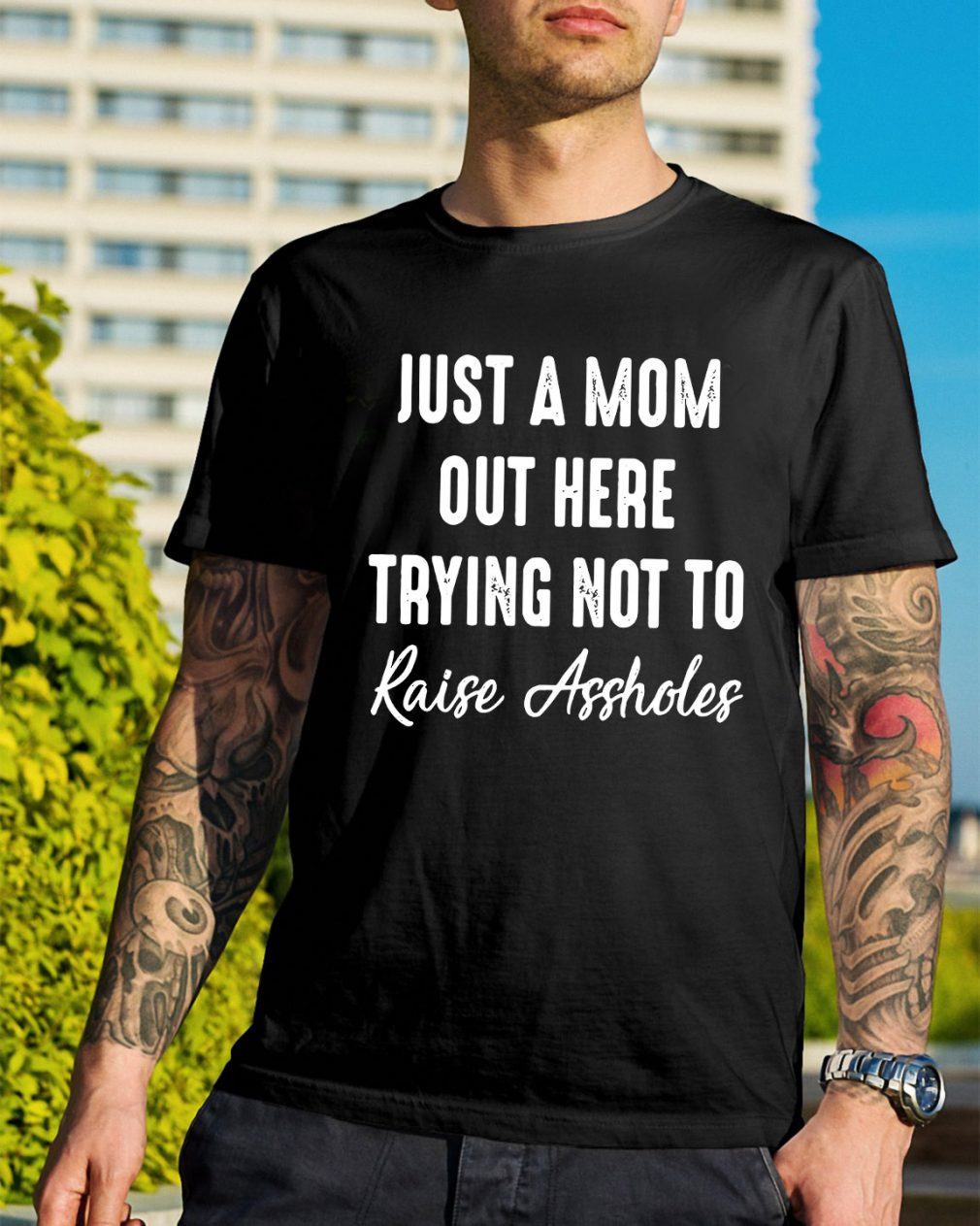 Just a mom out here trying not to raise assholes shirt