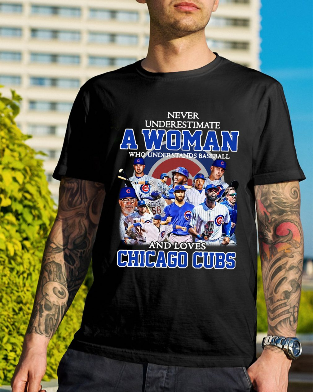 A woman who understands baseball and loves Chicago Cubs shirt