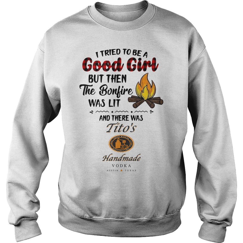 The bonfire was lit and there was Tito's Handmade Vodka Sweater